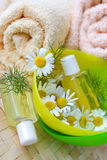 Bath - aromatheraphy - herbal healing lotion - camomile Stock Photo