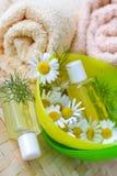 Bath - aromatheraphy - herbal healing lotion - camomile Stock Photo
