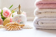 Bath arrangement with parfume bottle, folded towels Royalty Free Stock Photo