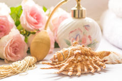Bath arrangement with parfume bottle, folded towels Stock Photos