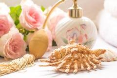 Bath arrangement with parfume bottle, folded towels Stock Photos