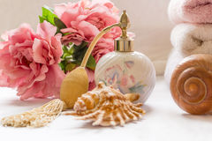 Bath arrangement with parfume bottle and pretty flowers Stock Images