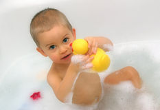 Bath a baby. Boy with toy Stock Image