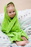 Bath a baby. Boy wrapped in green towel Royalty Free Stock Image