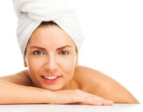 Bath beauty close-up portrait. Beauty portrait of a happy woman, wearing turban made of towel, relaxed, isolated on white Royalty Free Stock Photos