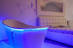 Bath in bedroom. Closeup of a neon bath in a modern bedroom royalty free stock photography