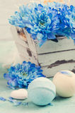Bath bombs and blue flowers Stock Photo