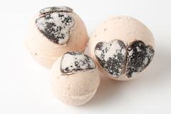 Bath bombs with chocolate hearts on a white. Background Royalty Free Stock Image