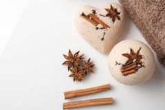 Bath bombs with cinnamon sticks and star anise. On a white background Royalty Free Stock Photos