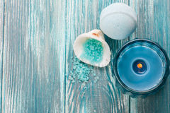 Bath bombs closeup with blue lit candle royalty free stock image