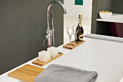 Bath with bottle of champagne. Bath with a bottle of champagne and glasses Royalty Free Stock Image