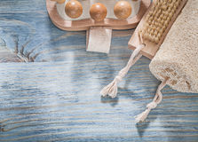 Bath brush loofah wooden massager on wood board spa concept Royalty Free Stock Photography