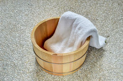 Bath bucket with a towel Royalty Free Stock Photography