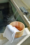 Bath bucket with a towel Stock Photo
