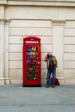 Bath Christmas Market - Red Telephone Booth With Christmas Bulb Royalty Free Stock Photography