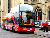 Bath City Tour Bus, outside Bath Abbey. A bath sightseeing bus waiting for passengers outside Bath Abbey, Bath, England, UK Royalty Free Stock Photography