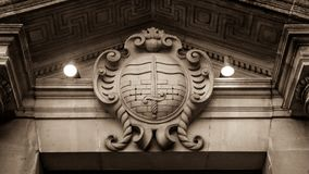 Bath Coat of Arms. English Crest of Bath, Plaque on Stone Wall, Vintage Keystone in Doorway, Architecture Detail in Sepia Tone low angle Stock Images