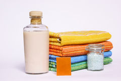 Bath composition. Bath items. Stack of clean multicolor towels, soap, bathfoam and bath salts Royalty Free Stock Photos