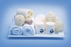 Bath Deco. Ration & Relaxation Kit. Fresh Clean White Towels, Candles and Decorative Elements. . Blue Tones Horizontal Studio Photo Stock Images