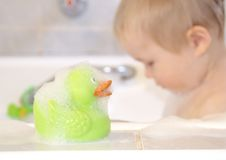 Bath duck and bathing boy Royalty Free Stock Photography