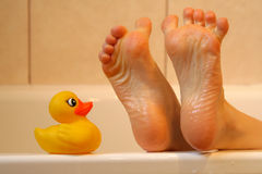 Bath duck meeting feet Royalty Free Stock Photo
