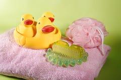 Bath ducks on towel Stock Images