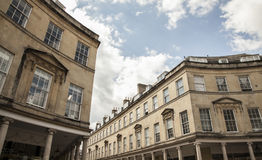 Bath, England - long stone buildings. This image shows a view of one of the streets in the city of Bath, England Stock Image
