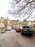 Bath England parking house real estate architecture. BATH, UNITED KINGDOM - MAR 7, 2017: Typical Bath England architecture real estate houses with cars parked in Royalty Free Stock Images