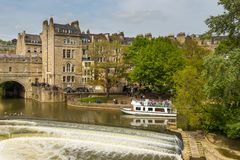 View of Pulteney Bridge and Weir on the River Avon, Bath, England, UK. Bath, England, UK- 04 May 2014: View of Pulteney Bridge and Weir on the River Avon in the Stock Photos
