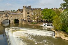 View of Pulteney Bridge and Weir on the River Avon, Bath, England, UK. Bath, England, UK- 04 May 2014: View of Pulteney Bridge and Weir on the River Avon in the Royalty Free Stock Photos
