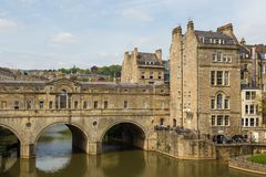 View of Pulteney Bridge and Weir on the River Avon, Bath, England, UK. Bath, England, UK- 04 May 2014: View of Pulteney Bridge and Weir on the River Avon in the Royalty Free Stock Photography