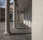 Bath, England - white columns. This image shows a view of one of the streets in the city of Bath, England Stock Images