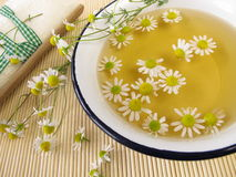 Bath essence with chamomile Stock Photos