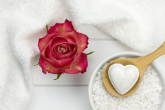 Bath fizzer in heart shape and red rose Royalty Free Stock Images