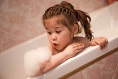Bath foam on the girl elbow Stock Image
