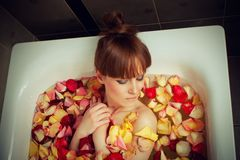 Bath full of rose petals Stock Images