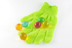 Bath glove and bath pearls Stock Photo