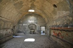 Bath House, Herculaneum. Bath House in Ancient Herculaneum. Herculaneum was buried in the eruption of Mount Vesuvius in AD 79. Unlike Pompeii, the pyroclastic Stock Photo