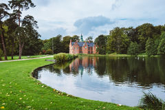 Bath House hunting lodge reflected on pond near Frederiksborg castle in Copenhagen, Denmark. Stock Photo