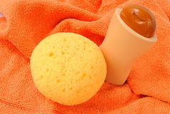 Bath items. For shower on the orange towel Stock Photo
