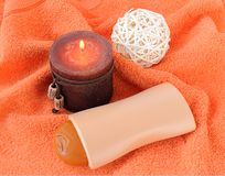 Bath items with a candle. Bath items for shower with a candle Royalty Free Stock Image
