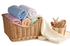 Bath items. Fluffy towels in a basket and bath items, isolated on white background Stock Photography