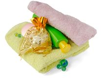 Bath items (light  pink and green). Bath items for shower (cream, shampoo, towel Royalty Free Stock Images