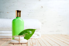 Bath items. soap, towel, liquid an fresh leaf Stock Photography
