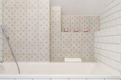 Bath in luxury beige bathroom. Close-up of bath in luxury beige bathroom Stock Image
