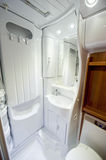 Bath of motor home. View inside a new motor home camper, bathroom detail with toilet and shower Royalty Free Stock Photos