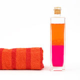 Bath oil. A bottle of bath oil and a towel Stock Images