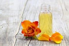 Free Bath Oil And Orange Rose Royalty Free Stock Photos - 49834498
