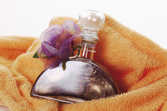 Bath oil with flower on towel Stock Photography