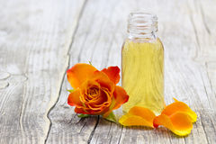 Bath oil and orange rose Royalty Free Stock Photos